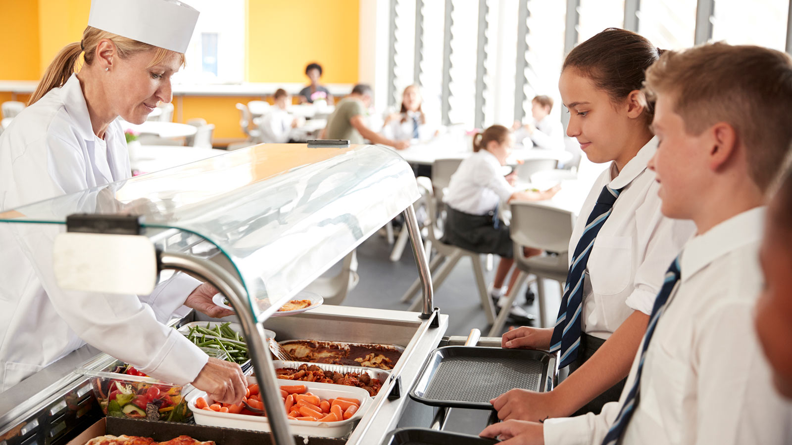 Image featuring pupils in a school cafeteria.