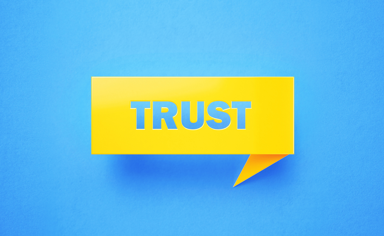 Trust Written Yellow Chat Bubble on Blue Background