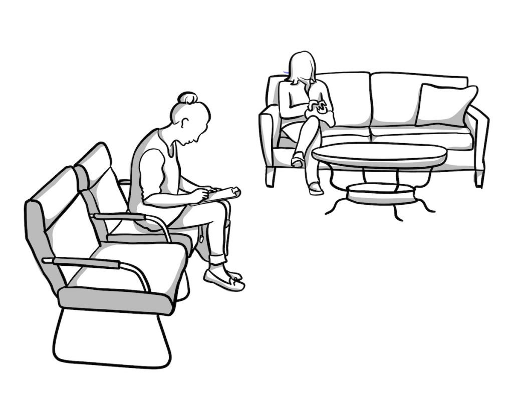 Persons seated in a waiting room filling out paperwork