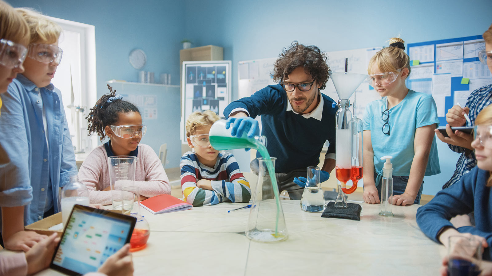Image of a teacher and students in a classroom laboratory