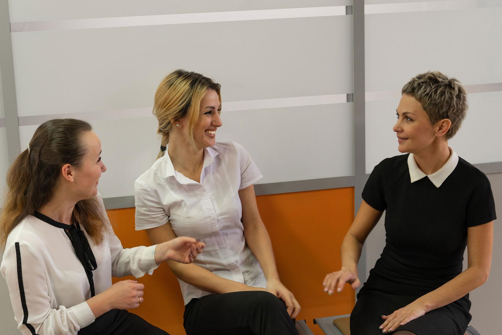 Image featuring women chatting in school staffroom.